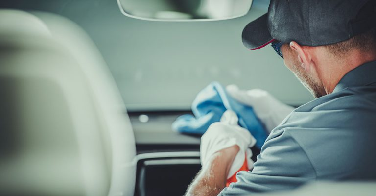 Modern Car Interior Cleaning and Detailing by Professional Caucasian Cleaner.